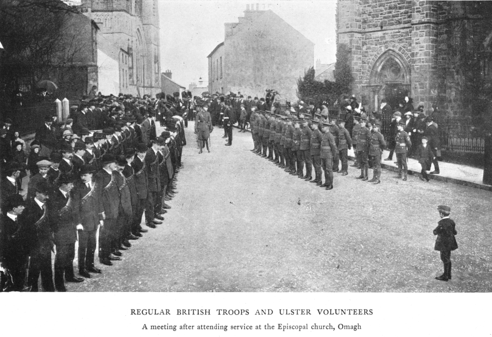 Members of the Ulster Volunteer Force, an early 20th century British terrorist organisation in Ireland, jointly parade with soldiers of the British Army in Omagh, Ireland, c.1914