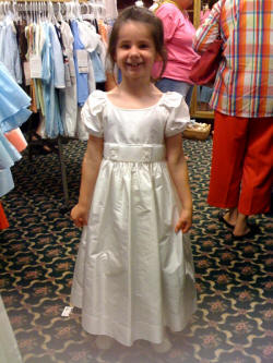 Stirling modeling her flower girl dress for an upcoming family wedding.