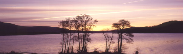 Winter sunset over Loch Lomond, near the village of Balmaha in the clan lands of Clan Buchanan. Looking over the Loch to the land of Clan Colquhoun.