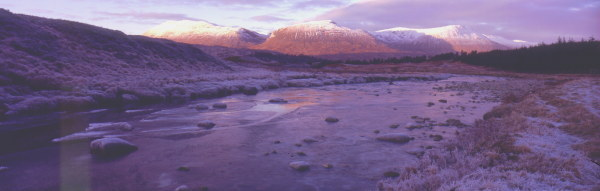 Winter twilight near Bridge of Orchy.Looking at three Munros (mountains over three thousand feet), Stob Coir' An  Albannaich, Stob Ghabhar, ClachLeathad. Lands with connections to Clan Campbell, Clan Henderson & Clan MacIntyre.