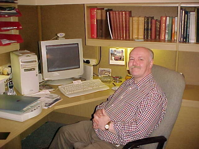 Alastair in his new office in 2002
